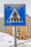 Traffic sign covered by ice and snow. Icy weather Stock Photo