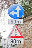 Traffic sign covered with snow indicates traffic light in 90 met Royalty Free Stock Image