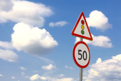 Traffic sign in the dark blue sky with clouds stock images