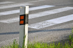 Traffic sign (delineator) determinate the edge of road.  Stock Photography