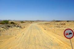 Traffic sign in desert Stock Images