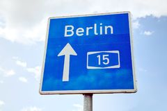 Traffic sign with direction to Berlin. Germany Royalty Free Stock Image