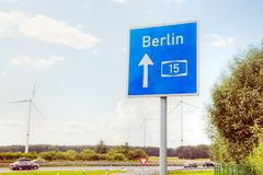 Traffic sign with direction to Berlin. Germany royalty free stock photo