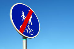 Traffic sign end of the trail for cyclists and pedestrians. Royalty Free Stock Images