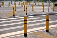 Traffic sign and facilities at road crossing Royalty Free Stock Images