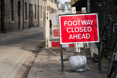 Traffic Sign: Footway Closed Ahead. On the road stock photography