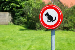 Traffic sign forbidden to let dogs poop here Royalty Free Stock Images
