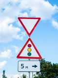 Give way road sign and traffic light royalty free stock images