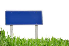 Traffic sign and grass Stock Photos