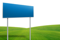 Traffic sign on green grass Royalty Free Stock Photography
