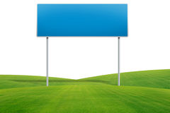 Traffic sign on green grass Royalty Free Stock Photo