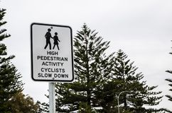 Traffic sign for High pedestrian Activity Cyclists slow down. A Traffic sign for High pedestrian Activity Cyclists slow down stock photography