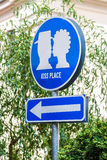 Traffic sign indicates kiss plase. Blue Traffic sign that indicates about the place of kisses in the garden Stock Image