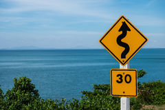 Traffic sign. Indicating a winding road must be using a speed of 30 kilometers per hour Royalty Free Stock Photography
