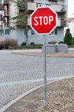 Traffic sign indicating that you need to stop in the street Stock Images