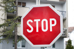 Traffic sign indicating that you need to stop in the street Royalty Free Stock Image