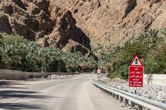 Traffic sign inffront of a wadi crossing. Traffic sign warning against crossing the path in case of a high water Royalty Free Stock Photos