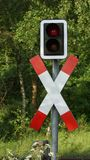 Traffic sign on the iron railroad crossing Stock Photography