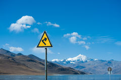 Traffic sign beside a lake. In Tibet, China Stock Photography