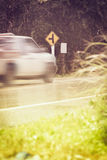 Traffic sign, motion blurred pick-up truck on public road  and T Royalty Free Stock Images