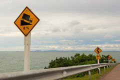 Traffic sign on mountain route. And sea stock images