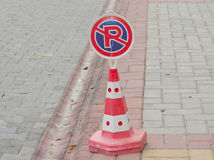 Traffic sign no parking. No parking road sign stands on the border between the road and sidewalk Royalty Free Stock Photo