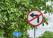 Traffic sign, no turn left on tree background. Stock Photos