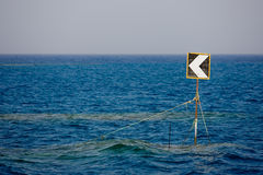 Traffic sign on the ocean. Stock Image