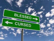 Blessed or cursed. A traffic sign with one way to blessed and the other towards cursed stock photography