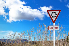 Traffic sign over dry grass Stock Images