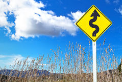 Traffic sign over dry grass Royalty Free Stock Photos