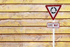 Traffic sign over wooden Royalty Free Stock Photo