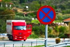 Traffic sign with parked truck Stock Photography
