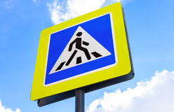 Traffic sign pedestrian crossing against the blue sky Royalty Free Stock Photos