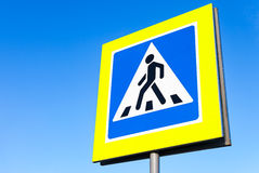 Traffic sign pedestrian crossing with blue sky Stock Photography