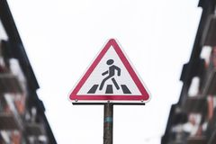 Traffic sign pedestrian crossing the road stock image