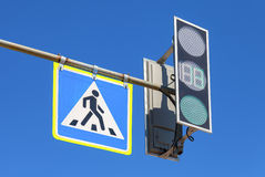 Traffic sign pedestrian crossing and traffic light with blue sky Stock Photo