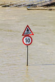 Traffic sign in and pierflood Stock Photos