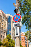 Traffic sign prohibiting parking with CCTV camera Stock Photo