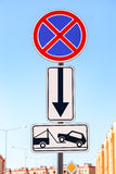 Traffic sign prohibiting parking. Evacuation on tow truck Royalty Free Stock Photography