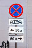 Traffic sign prohibiting parking. Evacuation on tow truck Royalty Free Stock Photo