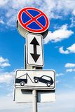 Traffic sign prohibiting parking. Evacuation on tow truck Royalty Free Stock Photos