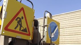 Traffic sign for road work on slowly moving truck. Street repair, highway construction stock footage