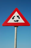 Traffic sign; roundabout Stock Images