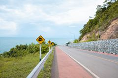 Traffic sign show beside road with beach view royalty free stock photos