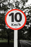 Traffic sign signaling speed limit of 10 kilometers per hour.  Stock Images