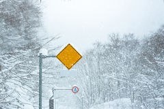 Traffic sign in snow Royalty Free Stock Photos