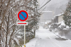 Traffic sign in snow Royalty Free Stock Image
