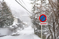 Traffic sign in snow Stock Images
