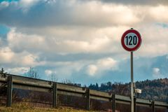 Traffic sign which means 120 kilometers per hour. Traffic sign. Speed limit of 120 kilometers per hour. Blue sky and clouds Royalty Free Stock Photography